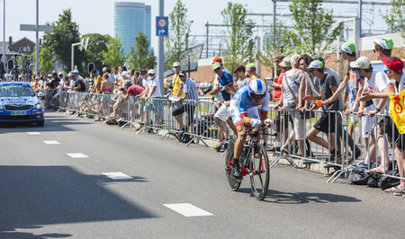 bystanders: Utrecht,Netherlands - 04 July 2015: The French cyclist Matthieu Ladagnous of FDJ Team riding during the first stage individual time trial  of Le Tour de France 2015 in Utrecht,Netherlands on 04 July 2015.