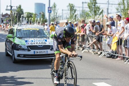 bystanders: Utrecht,Netherlands - 04 July 2015: The French cyclist Arnaud Gerard of  Bretagne-Seche Environnement Team riding during the first stage individual time trial  of Le Tour de France 2015 in Utrecht,Netherlands on 04 July 2015. Editorial
