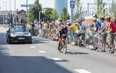 bystanders: Utrecht,Netherlands - 04 July 2015: The German cyclist Emanuel Buchmann of  Bora-Argon 18 Team riding during the first stage individual time trial  of Le Tour de France 2015 in Utrecht,Netherlands on 04 July 2015. Editorial
