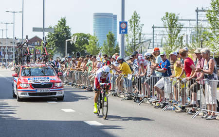 bystanders: Utrecht,Netherlands - 04 July 2015: The Portuguese cyclist Tiago Machado of Katusha Team riding during the first stage individual time trial  of Le Tour de France 2015 in Utrecht,Netherlands on 04 July 2015.
