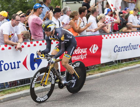 bystanders: Utrecht,Netherlands - 04 July 2015: The American cyclist Tyler Farrar, of MTN-Qhubeka Team riding during the first stage individual time trial  of Le Tour de France 2015 in Utrecht,Netherlands on 04 July 2015. Editorial