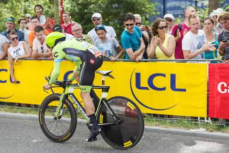 bystanders: Utrecht,Netherlands - 04 July 2015: The Australian cyclist Nathan Haas of  Team Cannondale-Garmin riding during the first stage individual time trial  of Le Tour de France 2015 in Utrecht,Netherlands on 04 July 2015.