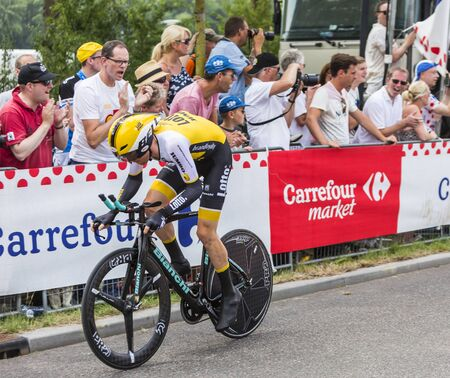 bystanders: Utrecht,Netherlands - 04 July 2015: The Dutch cyclist Steven Kruijswijk of  Team LottoNL-Jumbo riding during the first stage individual time trial  of Le Tour de France 2015 in Utrecht,Netherlands on 04 July 2015.