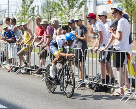 bystanders: Utrecht,Netherlands - 04 July 2015: The Australian cyclist Michael Matthews of OricaGreenEDGE Team riding during the first stage individual time trial  of Le Tour de France 2015 in Utrecht,Netherlands on 04 July 2015.