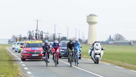 breakaway: Le Gaut Saint Denis,France- March 7,2016:Four cyclists in the breakaway riding in Eure et Loire region of France during the first stage of Paris-Nice 2016.