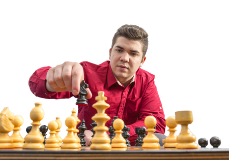 pawn adult: A young man playing chess isolated aginst a white background.