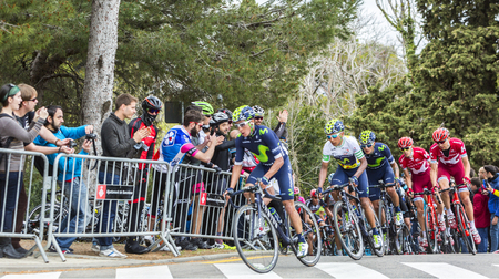 peloton: Barcelona, Spain - March27, 2016: The Colombian cyclist Nairo Quintana of Movistar Team riding in the peloton during Volta Ciclista a Catalunya, on the top of Montjuic in Bracelona Spain, on March 27, 2016. Quintana was te winner of the race. Editorial
