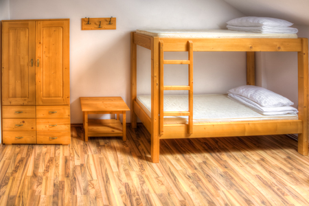 dormitory: Clean hostel room with wooden bunk beds.
