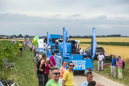 sponsors: Quievy,France - July 07, 2015:Krys Caravan during the passing of the Publicity Caravan on a cobblestoned road in the stage 4 of Le Tour de France on July 7 2015 in Quievy, France. Krys is an important chain of optical stores in France. Krys sponsors the W