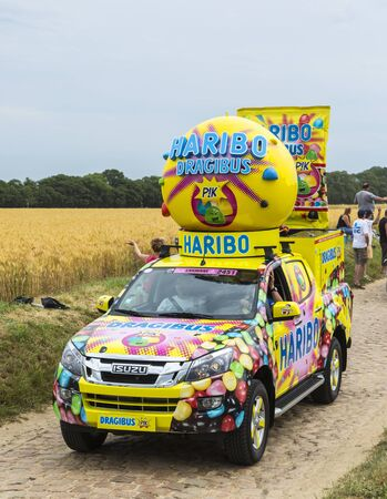worl: Quievy,France - July 07, 2015: Haribo vehicle during the passing of the Publicity Caravan on a cobblestoned road in the stage 4 of Le Tour de France on July 7 2015 in Quievy, France. Haribo is the biggest manufacturer of gummy and jelly sweets in the worl Editorial