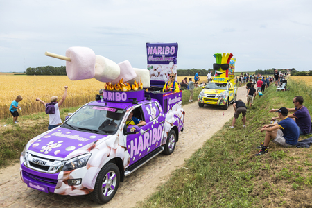 worl: Quievy,France - July 07, 2015: Haribo Caravan during the passing of the Publicity Caravan on a cobblestoned road in the stage 4 of Le Tour de France on July 7 2015 in Quievy, France. Haribo is the biggest manufacturer of gummy and jelly sweets in the worl Editorial