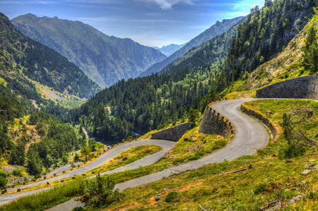 pyrenees: Winding road in Pyrenees Mountains - Lakes Road (Route des Lacs) in Neouvielle Massif. Stock Photo