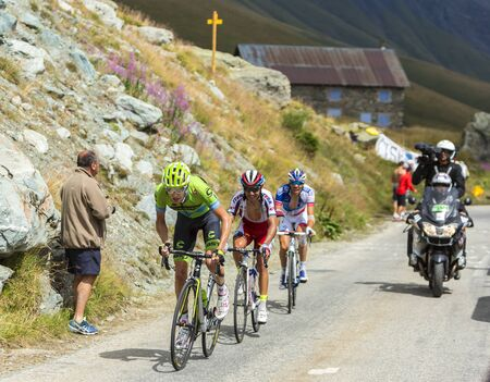 pinot: Col de la Croix de Fer, France - 23 July 2015:Group of three cyclists, Ryder Hesjedal of Team  Cannondale-Garmin,Joaquim Rodriguez of Team Katusha and Thibaut Pinot of FDJ Team, climbing to the Col de la Croix de Fer in Alps during the stage 20 of Le Tour Editorial