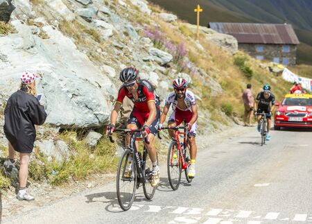 Col de la Croix de Fer, France - 23 July 2015:The cyclists Giampaolo Caruso of Katusha Team, Samuel Sanchez of BMC Racing Team and Nicolas Roche of Team Sky, climbing to the Col de la Croix de Fer in Alps during the stage 20 of Le Tour de France 2015. Editorial