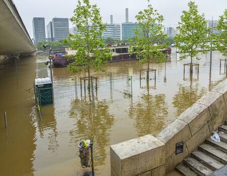 scourge: Paris,France - June 05, 2016: The embankment of River Seine is covered by water after the massive flooding in Paris during the first days of June 2016.