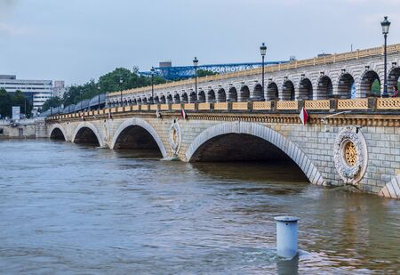 charles de gaulle: Paris,France - June 5, 2016: The River Seine has a high level at the Charles de Gaulle Bridge during the massive flooding in Paris in the first days of June 2016.