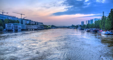 austerlitz: Paris,France - June 5, 2016: Paris cityscape with the River Seine at dusk during the massive flooding in Paris in the first days of June 2016. Editorial