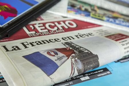 articles: Chartres,France - July 10, 2016: In the morning of the first day of UEFA Euro 2016 major French newspapers publish, both online and in print press, various articles related to the competition which will be held in France between June 10 and July 10, 2016. Editorial