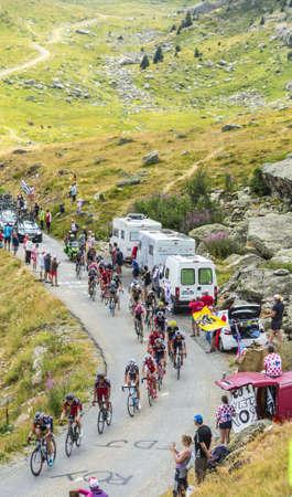 peloton: Col de la Croix de Fer, France - 23 July 2015: The peloton riding in a rocky natural environment at Col de la Croix de Fer in Alps during the stage 20 of Le Tour de France 2015.