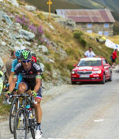 cansancio: Col de la Croix de Fer, France - 23 July 2015:The French cyclist Pierrick Fedrigo of Bretagne-Seche Environnement Team climbing to the Col de la Croix de Fer in Alps during the stage 20 of Le Tour de France 2015. Editorial