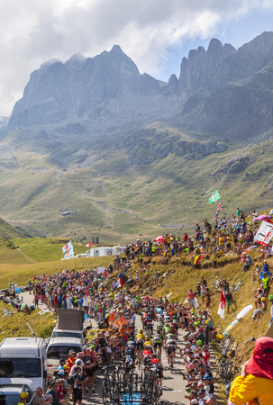 peloton: Col du Glandon, France - 23 July 2015: The peloton riding in a beautiful curve at Col du Glandon in Alps during the stage 18 of Le Tour de France 2015.