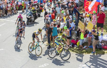 alberto: Col du Glandon, France - July 23, 2015: Alberto Contador of  Tinkoff-Saxo Team riding in front of a group of cyclists in a beautiful curve at Col du Glandon in Alps during the stage 18 of Le Tour de France 2015.
