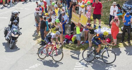 mountain bicycling: Col du Glandon, France - July 23, 2015: Alejandro Valverde of Movistar Team and Bauke Mollema of Trek Factory Racing Team riding in a beautiful curve at Col du Glandon in Alps during the stage 18 of Le Tour de France 2015.