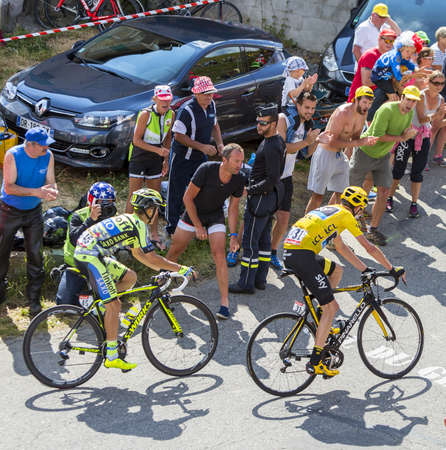 chris: Col du Glandon, France - July 23, 2015: Chris Froome in Yellow Jersey followed by Rafal Majka of Thinkoff-Saxo Team, riding in a beautiful curve at Col du Glandon in Alps during the stage 18 of Le Tour de France 2015. Editorial