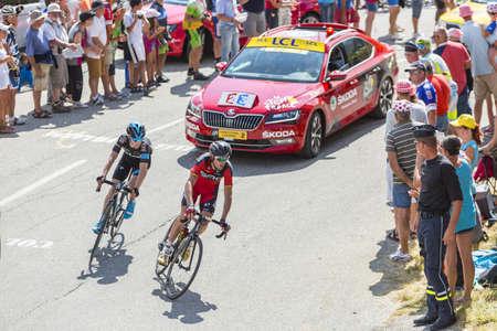 samuel: Col du Glandon, France - July 23, 2015: Samuel Sanchez Gonzalez of BMC Racing Team and Leopold Konig of Team Sky riding in a beautiful curve at Col du Glandon in Alps during the stage 18 of Le Tour de France 2015.