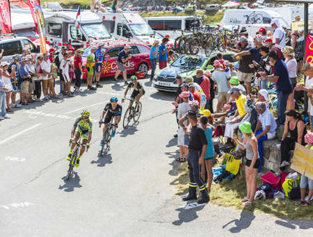 le roche: Col du Glandon, France - July 23, 2015: Roman Kreuziger of Tinkoff-Saxo Team,Nicolas Roche of Team Sky and Florian Vachon of Bretagne-Seche Environnement Team riding in a beautiful curve at Col du Glandon in Alps during the stage 18 of Le Tour de France 2