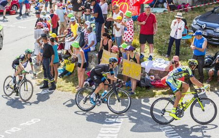 Col du Glandon, France - July 23, 2015: Roman Kreuziger of Tinkoff-Saxo Team,Nicolas Roche of Team Sky and Florian Vachon of Bretagne-Seche Environnement Team riding in a beautiful curve at Col du Glandon in Alps during the stage 18 of Le Tour de France 2