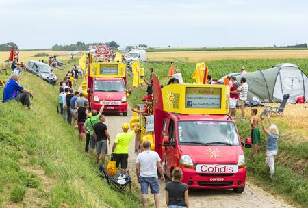 lending: Quievy,France - July 07, 2015: Cofidis Caravan during the passing of the Publicity Caravan on a cobblestoned road in the stage 4 of Le Tour de France on July 7 2015 in Quievy, France. Cofidis in an important French money lending company.