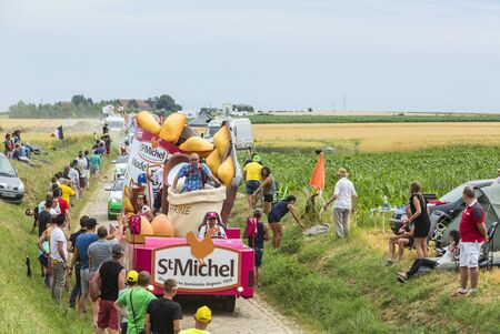 st  michel: Quievy,France - July 07, 2015: St. Michel Madeleines Caravan during the passing of the Publicity Caravan on a cobblestoned road in the stage 4 of Le Tour de France on July 7 2015 in Quievy, France.