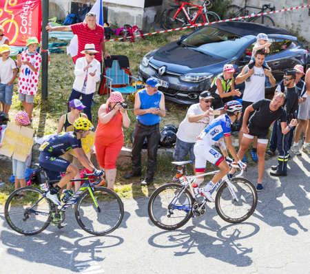 pinot: Col du Glandon, France - July 23, 2015: Thibaut Pinot of FDJ Team and Izagirre Insausti of Movistar Team riding in a beautiful curve at Col du Glandon in Alps during the stage 18 of Le Tour de France 2015.