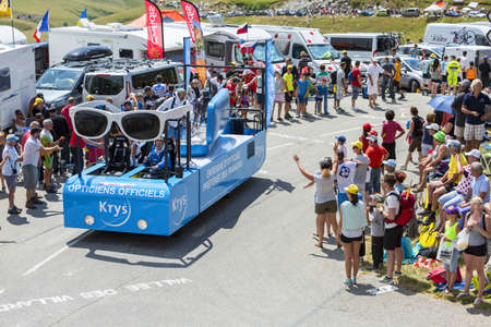 sponsors: Col du Glandon, France - July 23, 2015: Krys vehicle during the passing of the Publicity Caravan on Col du Glandon in Alps during the stage 18 of Le Tour de France 2015. Krys is an important chain of optical stores in France. Krys sponsors the White Jerse