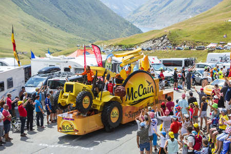 mc: Col du Glandon, France - July 23, 2015: Mc Cain vehicle during the passing of the Publicity Caravan on Col du Glandon in Alps during the stage 18 of Le Tour de France 2015. Mc Cain is a market leader in frozen products made from potatoes.