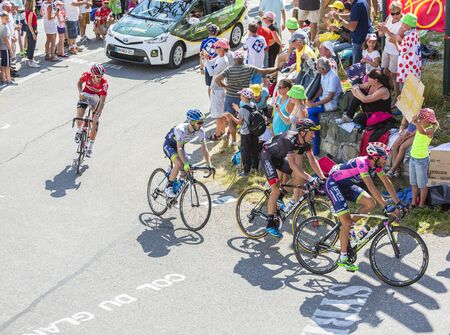 bono: Col du Glandon, France - July 23, 2015: Group of cyclists riding on the road to Col du Glandon in Alps during the stage 18 of Le Tour de France 2015. Editorial