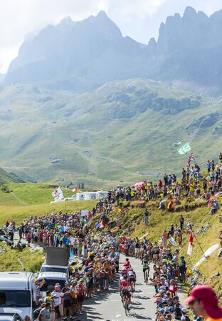 Col du Glandon, France - July 23, 2015: Group of cyclists riding on the road to Col du Glandon in Alps during the stage 18 of Le Tour de France 2015. Editorial