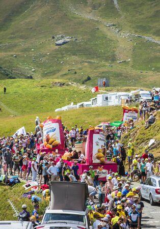 st michel: Col du Glandon, France - July 23, 2015: St. Michel Madeleines caravan during the passing of the Publicity Caravan on Col du Glandon in Alps during the stage 18 of Le Tour de France 2015.