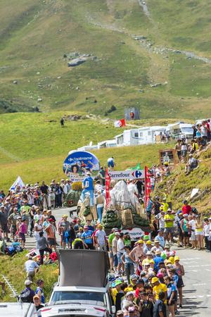 carrefour: Col du Glandon, France - July 23, 2015: Carrefour caravan during the passing of the Publicity Caravan on Col du Glandon in Alps during the stage 18 of Le Tour de France 2015.