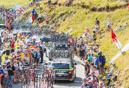 mountain bicycling: Col du Glandon, France - 23 July 2015: Row of technical cars driving on the road to Col du Glandon in Alps during the stage 18 of Le Tour de France 2015.