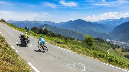 Col DAspin,France- July 15,2015: The Ukarainian cyclist Andriy Grivko of Astana Team, climbing the road to Col DAspin  in Pyrenees Mountains during the stage 11 of Le Tour de France 2015.