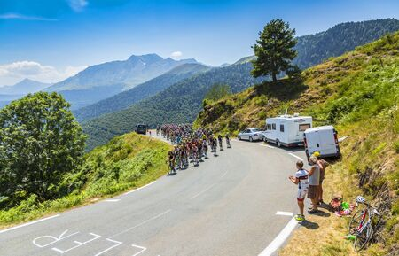 peloton: Col DAspin,France- July 15,2015: The peloton climbing the road to Col DAspin  in Pyrenees Mountains during the stage 11 of Le Tour de France 2015.