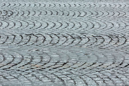 cobblestone road: Detail of cobblestone road. Location: Champs Elysees, Paris.