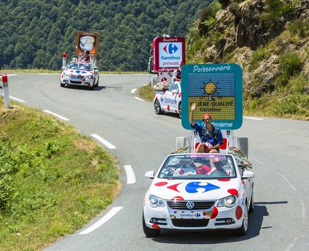 Col DAspin,France- July 15,2015: Carrefour Caravan during the passing of the Publicity Caravan on the Col dAspin in Pyerenees Mountains in the stage 11 of Le Tour de France 2015.