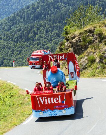 le: Col DAspin,France- July 15,2015: Vittel Caravan during the passing of the Publicity Caravan on the Col dAspin in Pyerenees Mountains in the stage 11 of Le Tour de France 2015. Vittel is a French bottled water brand.