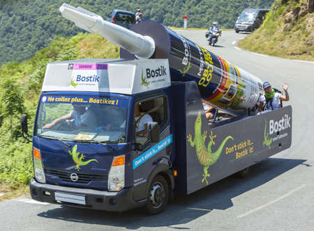 lending: Col DAspin,France- July 15,2015: Bostik Vehicle during the passing of the Publicity Caravan on the Col dAspin in Pyerenees Mountains in the stage 11 of Le Tour de France 2015. Cofidis is an important French money lending company. Bostik is a leading glo