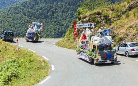 carrefour: Col DAspin,France- July 15,2015: Carrefour Caravan during the passing of the Publicity Caravan on the Col dAspin in Pyerenees Mountains in the stage 11 of Le Tour de France 2015.
