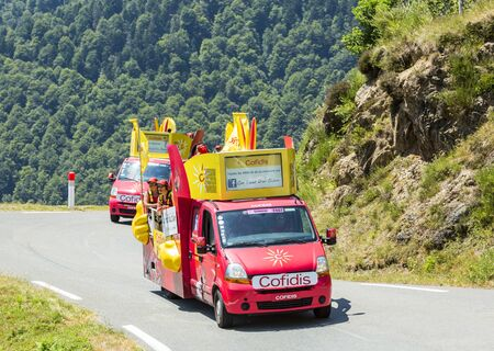 lending: Col DAspin,France- July 15,2015: Cofidis Caravan during the passing of the Publicity Caravan on the Col dAspin in Pyerenees Mountains in the stage 11 of Le Tour de France 2015. Cofidis is an important French money lending company.