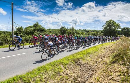 coutryside: Quineville,France- July 2, 2016: The peloton riding during the first stage of Tour de France in Quineville, France on July 2, 2016.